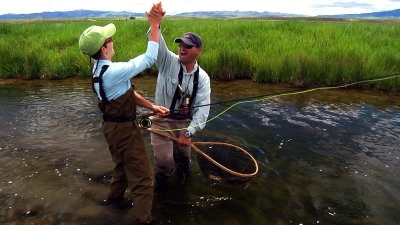Guest & Guide Enjoying Fly Fishing on Private Montana Waters