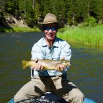 Happy guest with a nice Brown Trout caught on the Smith River