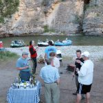 Guests enjoying appetizers at camp on the Smith River