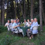 Guests enjoying dinner at camp on the Smith River