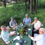 Guests enjoying some wine and relaxing at camp on the Smith River