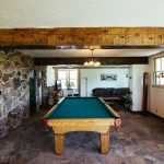 Recreation space with pool table at Healing Waters Lodge